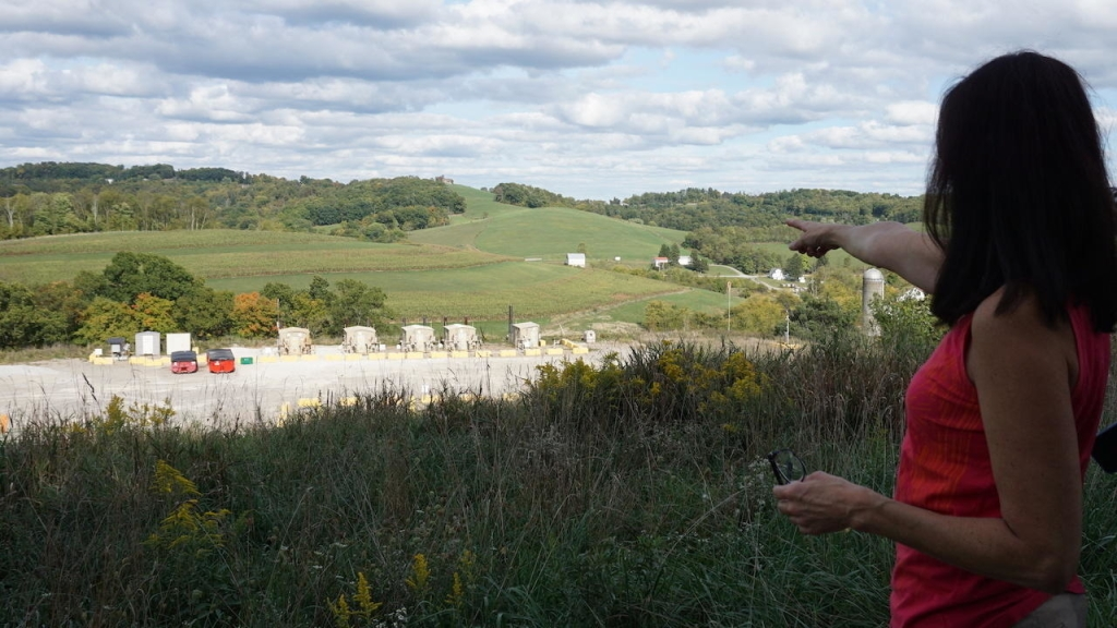 Lois Bower-Bjornson points out a fracking well site in southwest Pennsylvania